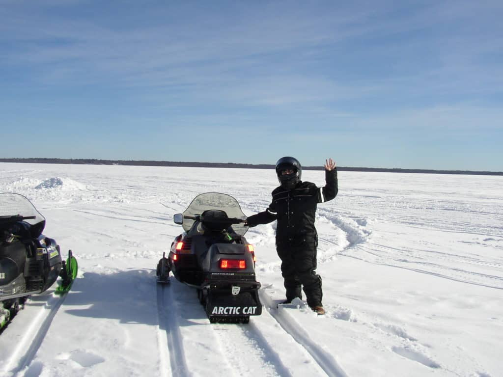 Frozen Lake with Snowmobiles
